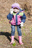 Little girl wearing rubber boots — Stock Photo
