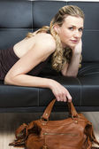 Portrait of woman with a handbag — Stock Photo