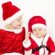 Stock Photo: Two little girls as SantClauses