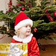 Little girl as Santa Claus with Christmas present — Foto Stock