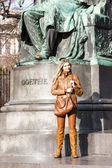 Woman standing by Johann Wolfgang Goethe''s statue, Vienna, Aust — Stock Photo