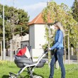 Womwith pram on walk — Stock Photo #37371751