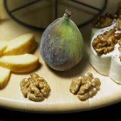 Cheese still life with fig — Stock Photo