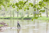 Woman fishing in Sazava river, Czech Republic — Stock Photo