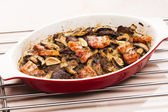 Baked chicken livres with bacon and mushrooms on garlic — Stock Photo