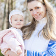 Stock Photo: Portrait of mother with little daughter