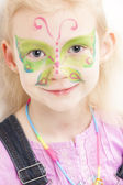 Portrait of little girl with face painting — Stock Photo