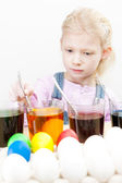 Little girl during Easter eggs coloration — Stock Photo