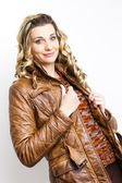 Portrait of standing woman wearing brown jacket — Photo