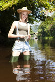 Woman fishing — Stock Photo