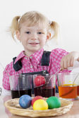 Little girl coloring Easter eggs — Stock Photo