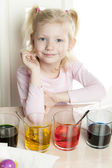 Girl coloring Easter eggs — Stock Photo