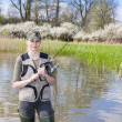 Stock Photo: Womfishing in pond in spring