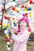 little girl standing by Easter tree — Stock Photo
