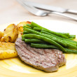 Foto Stock: Beefsteak with vegetables
