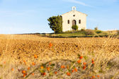 Chapel with field — Stock Photo