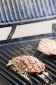 Beefsteak on electric grill — Stok fotoğraf