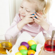 Little girl during Easter eggs' coloration — Stock Photo