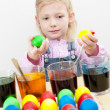 Litle girl coloring Easter eggs — Stock Photo