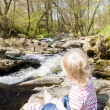 Little girl sitting by Vyrovka brook — Stock Photo