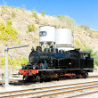 Steam locomotive at railway station — Stock Photo