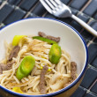Asian noodles with beef meat and leek — Stock Photo