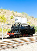 Steam locomotive at railway station — Foto Stock