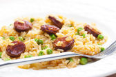 Risotto with chorizo and pea — Stock Photo