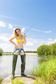 Woman fishing at pond — Stock Photo