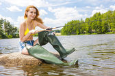 Woman sitting and fishing — Stock Photo