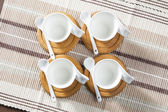 Coffee cups on place mats — Stock Photo