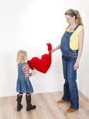 Girl with mother holding a heart — Stock Photo