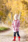 Girl in autumnal alley — Stock Photo