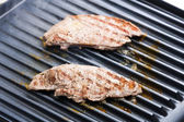 Beefsteaks on electric grill — Stock Photo