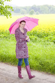Woman wearing rubber boots — Stock Photo