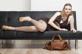 Woman  lying on sofa — Stock Photo
