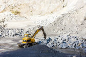Excavator loading rocks at quarry — Stock Photo