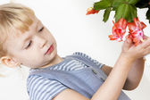 Portrait of little with Christmas cactus — Stock Photo