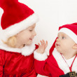 Two little girls as Santa Clauses — Stock Photo #48616349