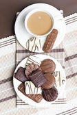 Cup of coffee with chocolate biscuits — Stock Photo