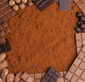 Still life of chocolate in cocoa — Stock Photo