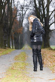 Woman wearing black clothes and boots — Stock Photo