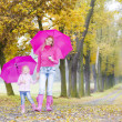 Mother and her daughter with umbrellas — Stock Photo #51127121