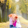 Mother and her daughter with umbrella — Stock Photo #51127141