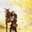 Equestrian with her horse — Stock Photo #51127289
