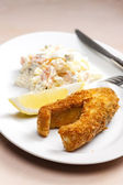 Fried carp with salad — Stock Photo