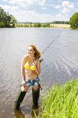 Young woman fishing — Stock Photo