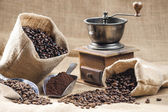 Coffee beans in jute bags — Stock Photo