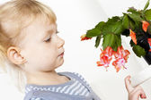 Girl with Christmas cactus — Stock Photo