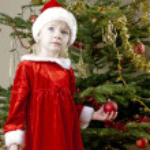 Santa Claus by Christmas tree — Stock Photo #7587549